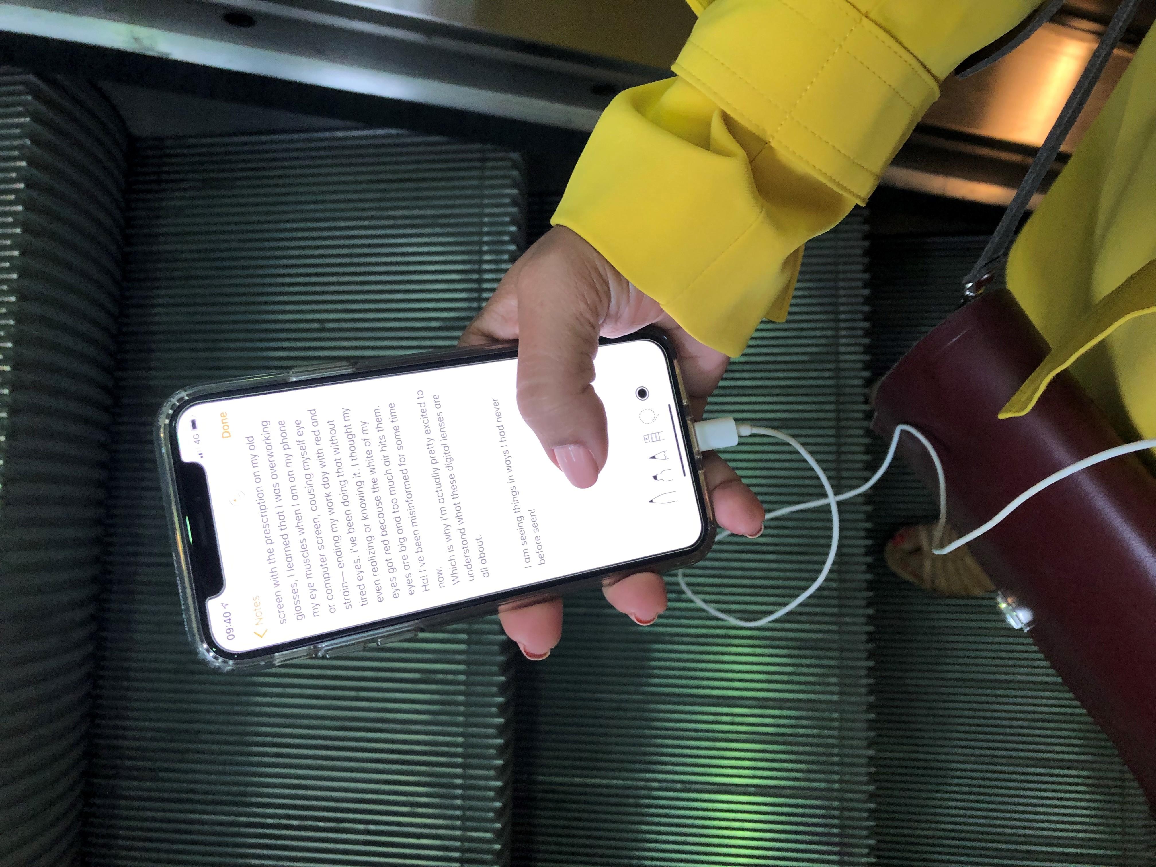 Digital Lenses Day One Phone on Escalator Image